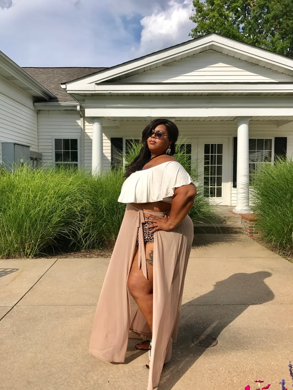 Plus Size resort wear from Honey's Child Boutique is perfect for a plus size pool party or a simple summer night out at the pool. Esther WIlliams swim bottoms, nude mesh cover up and cut out top and ruffle cover up make the perfect high-end look.