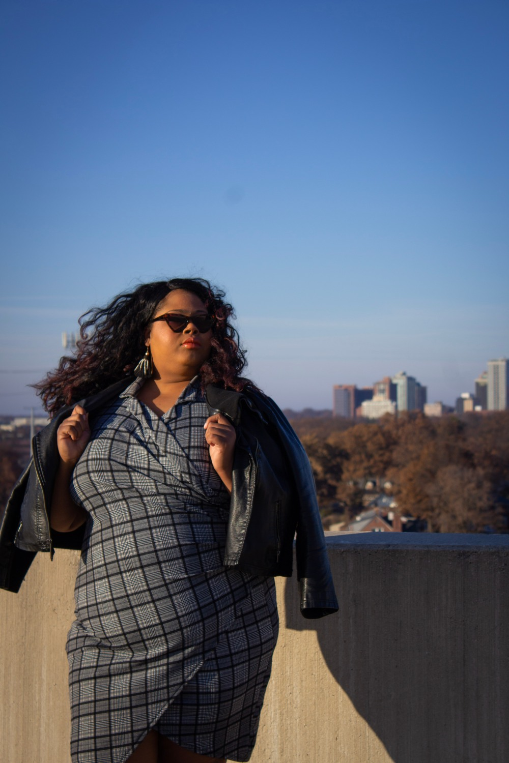 Woman in plaid on rooftop http://finessecurves.com
